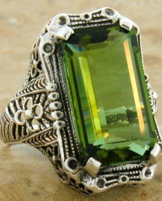Looking for this green stone silver tone ring. - SeenIt