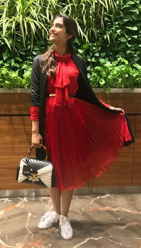 Want that red pleated midi dress that Sonam Kapoor is wearing. - SeenIt