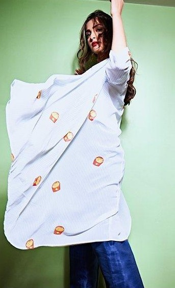 Find me this french fries printed white shrug that Sonam Kapoor is wearing. - SeenIt