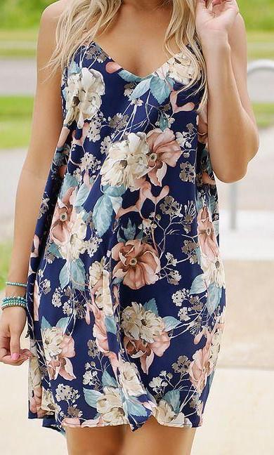 Help me find a similar navy blue floral cami dress. - SeenIt
