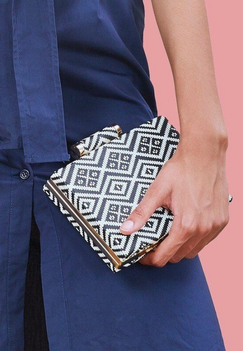 Looking for this black and white aztec clutch online!! - SeenIt