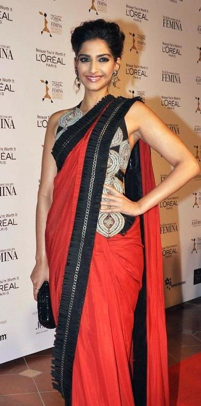 Looking for a similar red saree with black border as seen on Sonam Kapoor. - SeenIt