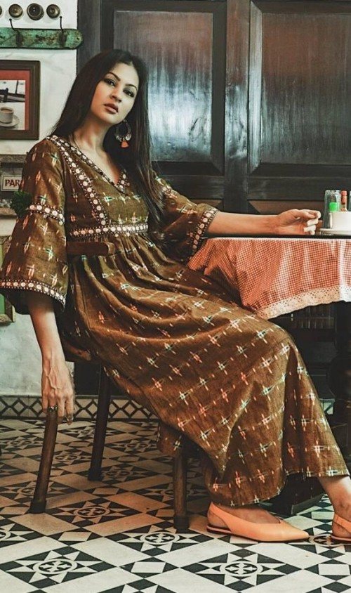 Help me find this mustard ikat maxi dress with bell sleeves that mscocoqueen is wearing. - SeenIt
