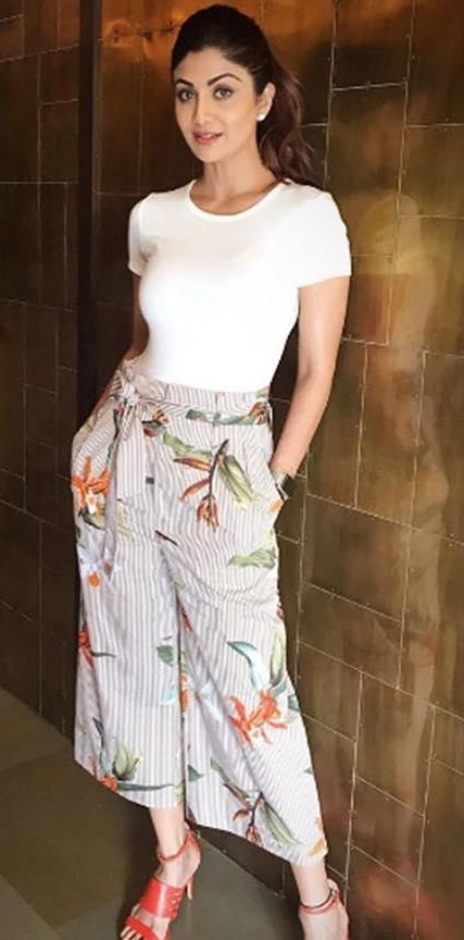 Help me find this khaki striped and floral print pants and white top that Shilpa Shetty is wearing. - SeenIt