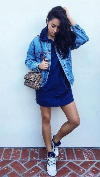 8363f31aee2 Looking for Shay Mitchell s blue t-shirt dress and denim jacket with white  sneakers -
