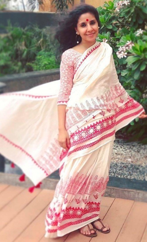 Want this ivory and red block printed saree with tassels. - SeenIt