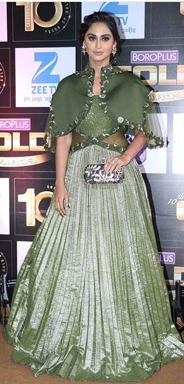 Yay or Nay? Krystal D Souza wearing a green cape embellished gown at Zee Gold Awards - SeenIt