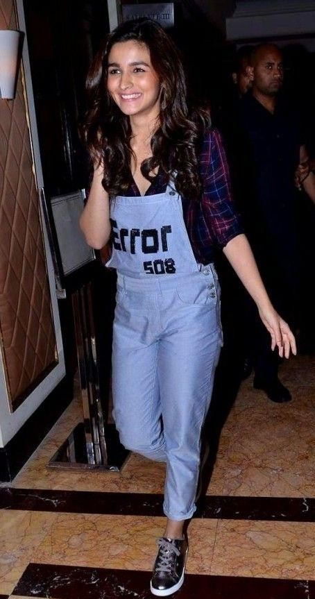 Looking for these blue coloured overalls which Alia is wearing.Domestic sites.The same overalls with the text and metallic sneakers. - SeenIt