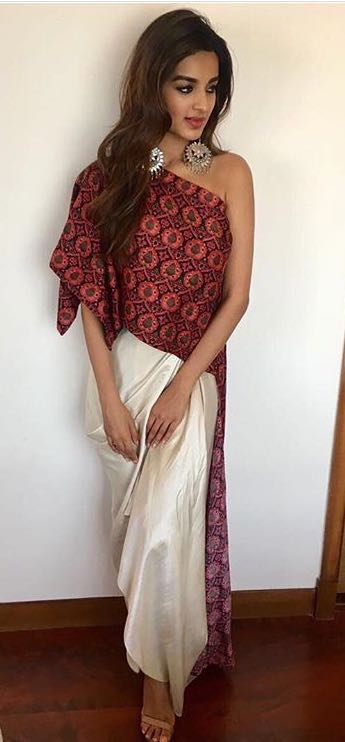 8186778e12 Help me find a similar outfit..cream draped maxi skirt and one shoulder  printed