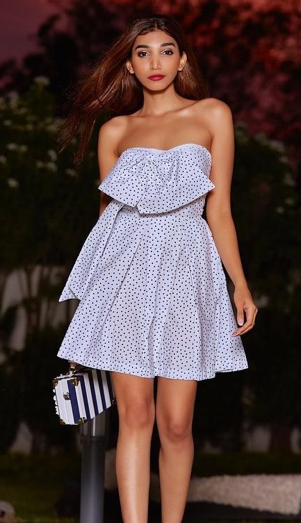 Help me find this white polka dot strapless flared dress with bow detail that Juhi Godambe is wearing. - SeenIt