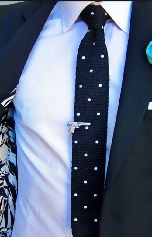 Help me find this navy blue knit polka dot tie and the silver tie bar. - SeenIt