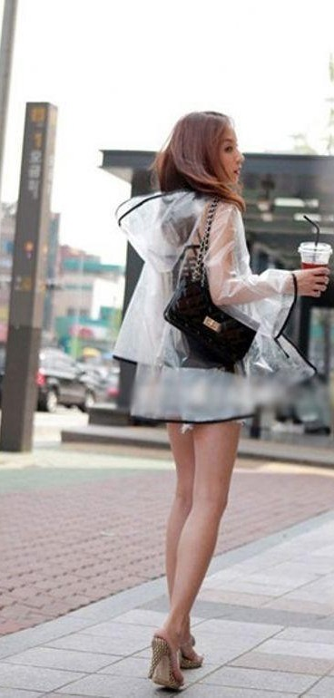I am looking for a similar clear black piping raincoat as seen on her. - SeenIt