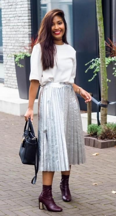I am looking for a metallic silver skirt and white top as seen on her. - SeenIt