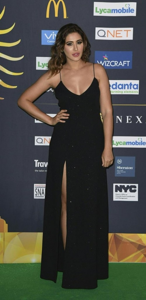 Yay or Nay? Nargis Fakhri wearing a black spaghetti slit gown at the Green Carpet during the IIFA weekend - SeenIt