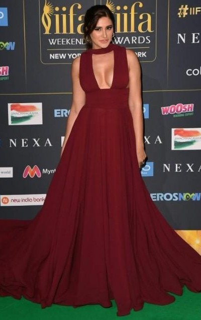 Yay or Nay? Nargis Fakhri wearing a maroon Gauri & Nainika plunging neckline gown at the IIFA night in New York - SeenIt