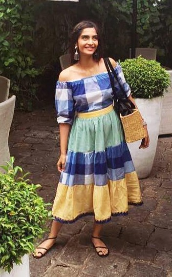Looking for this blue and yellow checkered off shoulder midi flared dress that Sonam Kapoor is wearing. - SeenIt