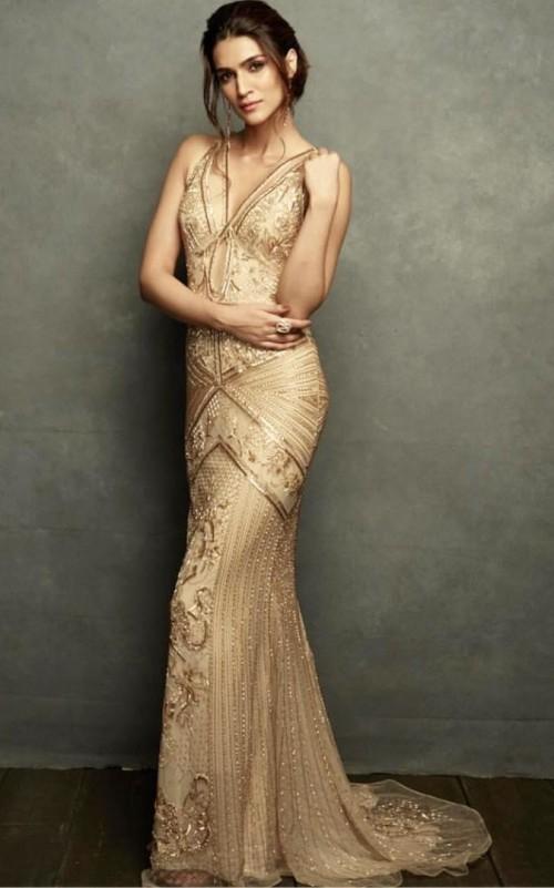 Yay or Nay? Kriti Sanon wearing a Roberto Cavalli golden gown at the IIFA awards night - SeenIt
