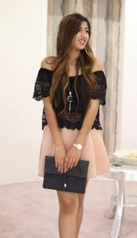 Want the black off shoulder top, beige skater skirt and the black clutch - SeenIt
