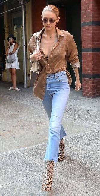 Help me find this brown shirt, fringed hem jeans and leopard print boots like Gigi Hadid is wearing. - SeenIt