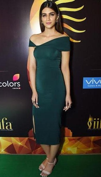 Help me find this emerald green one shoulder bodycon midi dress that Kriti Sanon is wearing. - SeenIt