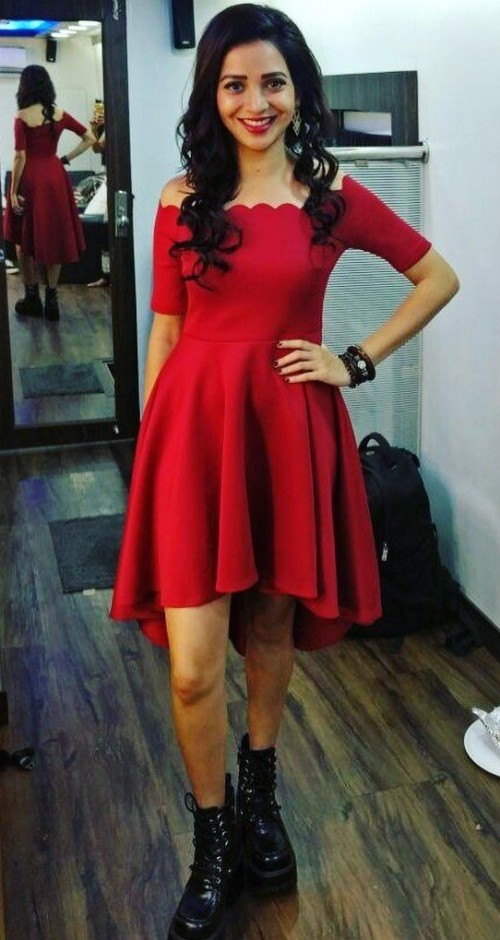 Help me find this red off shoulder dress that Plabita is wearing. - SeenIt