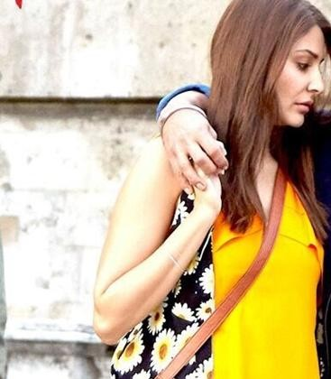 Looking for this sleeveless black shrug with those white and yellow flowers which anushka sharma is wearing.The same from domestic sites.TIA. - SeenIt