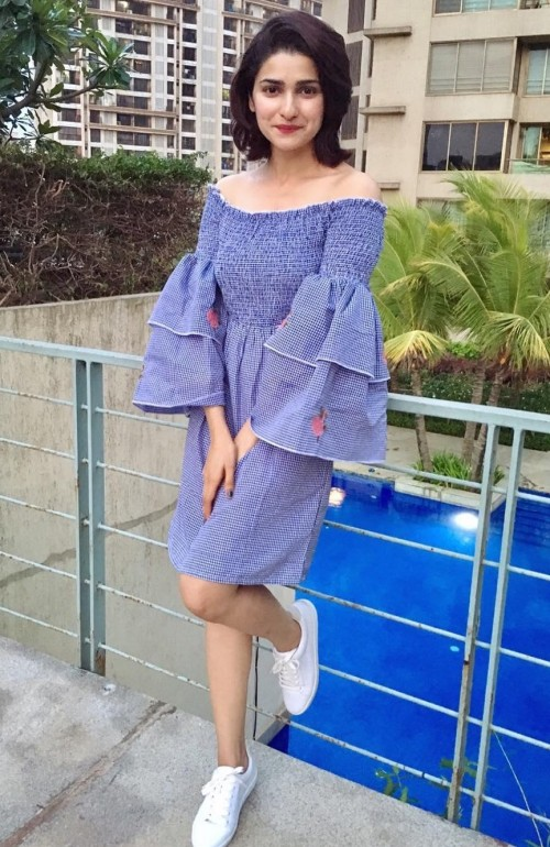 I am looking for this bell sleeve blue off shoulder dress and white sneakers as seen on Prachi Desai, help - SeenIt