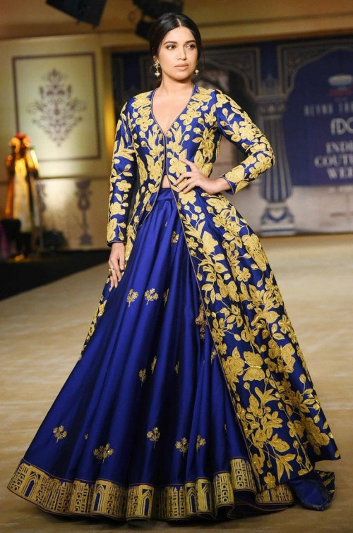 Yay or Nay? Bhumi Padnekar walks the ramp in a golden and blue embroidered jacket lehenga for Reynu Tandon's show during the India Couture Week 2017 - SeenIt