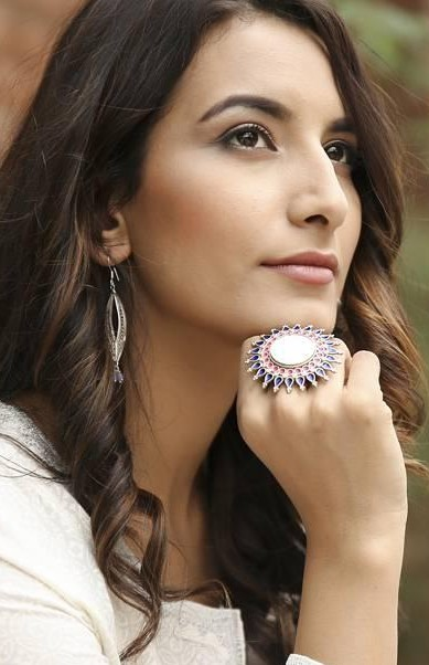 Find this silver statement ring with blue and pink stones. - SeenIt