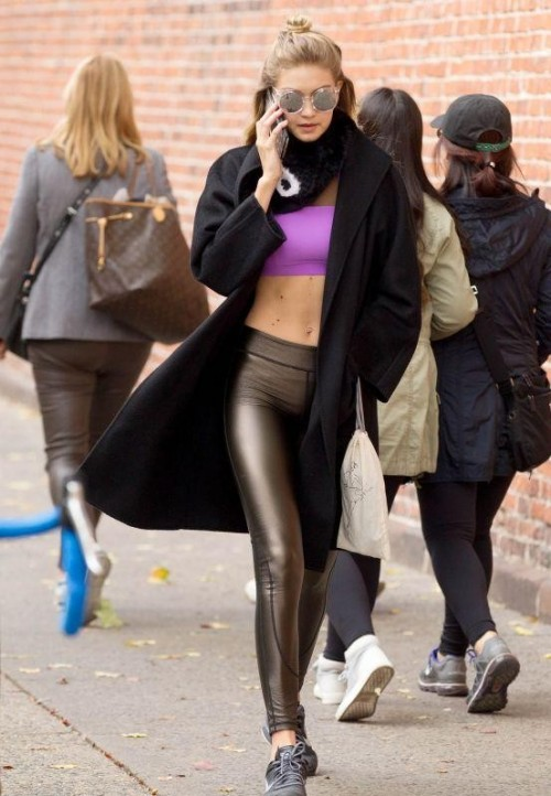 Want the purple bandeau bralet , black coat and black leather leggings which Gigi Hadid is wearing - SeenIt