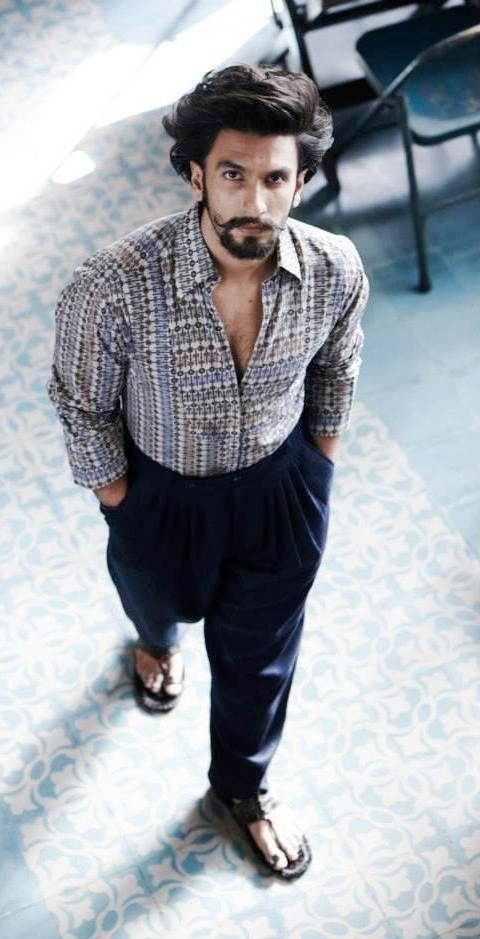 Looking for this printed shirt and black trousers as Ranveer Singh is wearing - SeenIt