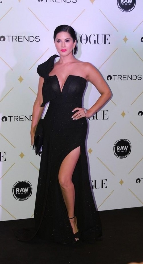 Yay or Nay? Sunny Leone wearing a black slitted plunging neckline gown at the Vogue Beauty Awards held last night in Mumbai - SeenIt