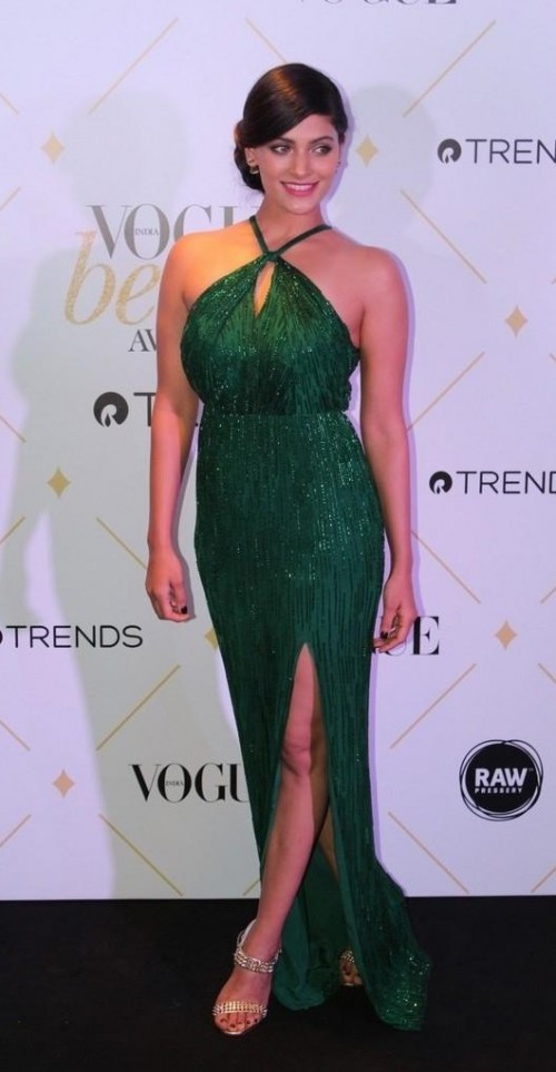 Yay or Nay? Saiyami Kher wearing a cross neck halter emerald green gown at the Vogue Beauty Awards 2017 - SeenIt