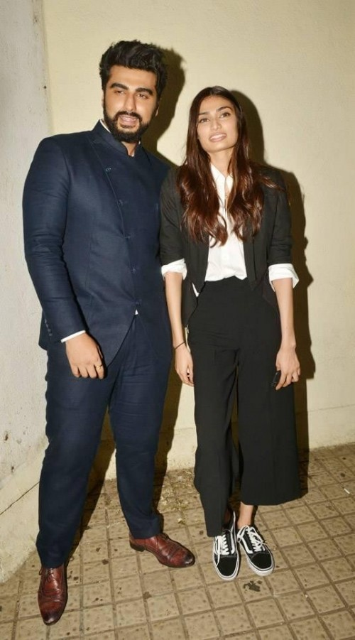 Help me find a similar pair of black culottes , blazer and white shirt that Athiya Shetty is wearing for the screening of Mubarak movie - SeenIt