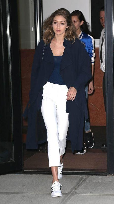Looking for the blue top with white pants and navy blue shrug that Gigi Hadid is wearing - SeenIt