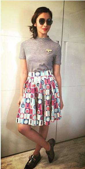 Looking for the black and white striped t-shirt, printed high-waisted skirt and black metallic shoes which Alia Bhatt is wearing - SeenIt