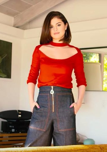 Looking for a similar red cut out top and culottes that Selena Gomez is wearing on 73 Questions with Vogue - SeenIt