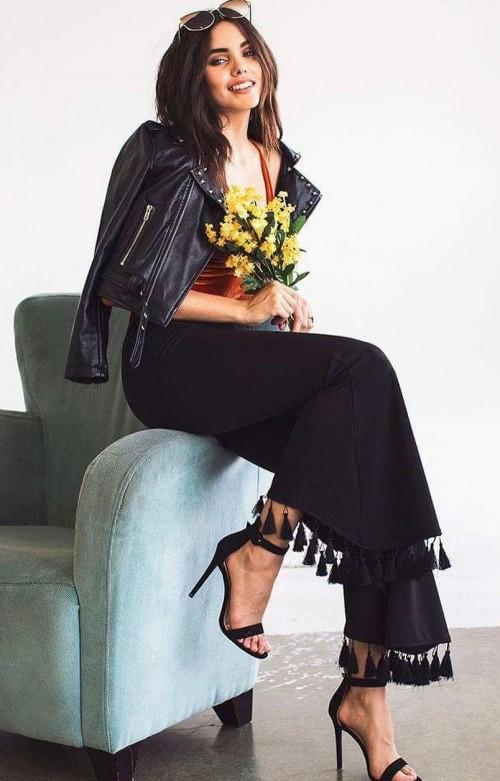 Help me find a similar black flared pants with tassels and leather jacket online!! - SeenIt