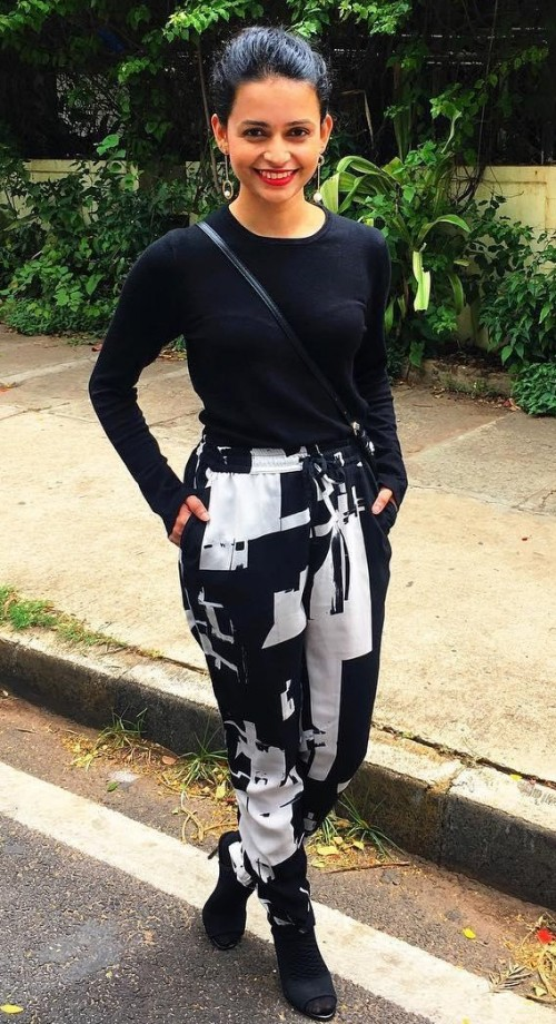 Looking for this monochrome printed pants, black top and ankle boots. - SeenIt