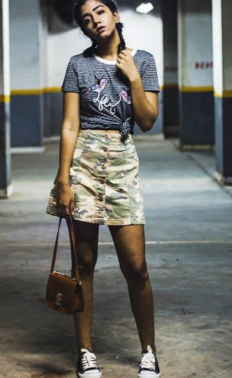 Help me find a similar camo print front button mini skirt, grey striped tshirt and black and white converse shoes. - SeenIt