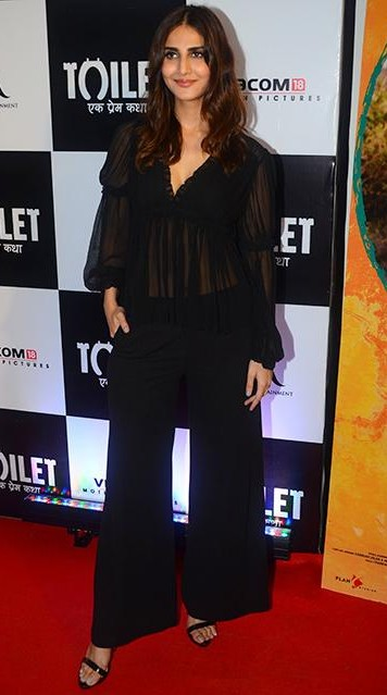 Help me find a similar black sheer top and flared pants like Vaani Kapoor is wearing. - SeenIt