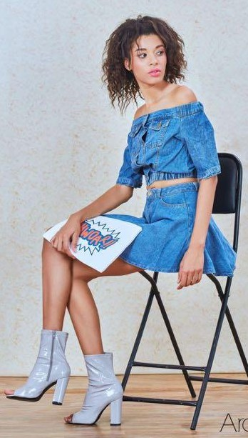 want the blue denim off shoulder and skirt (i think it is arabella) and the the silver heels - SeenIt