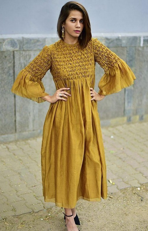 Help me find this mustard yellow tunic dress with bell sleeves. - SeenIt