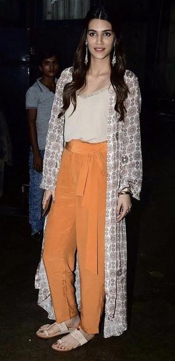 Want the cream top, printed cape ,orange pants and the kolhapuri chappals which Kriti Sanon is wearing while promoting bareilly ki barfi - SeenIt