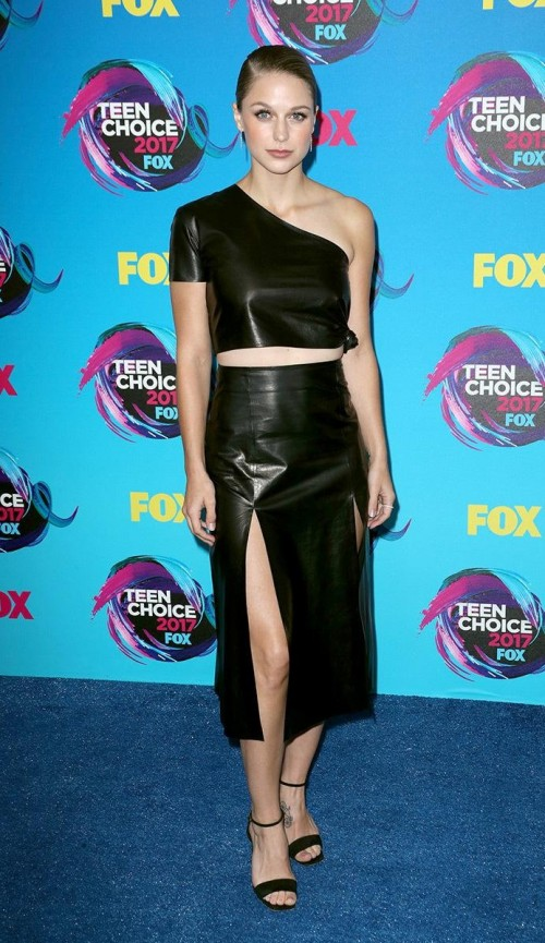 Yay or Nay? Melissa Benoist wearing a one-shoulder black leather crop top with midi slit skirt at the Teen Choice Awards. - SeenIt
