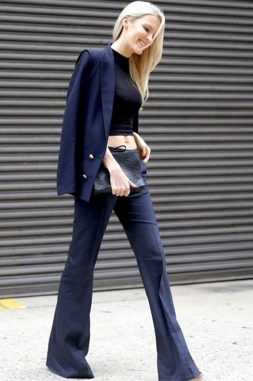 Want a navy blazer, black croptop, and navy trousers similar to the ones which she's wearing - SeenIt