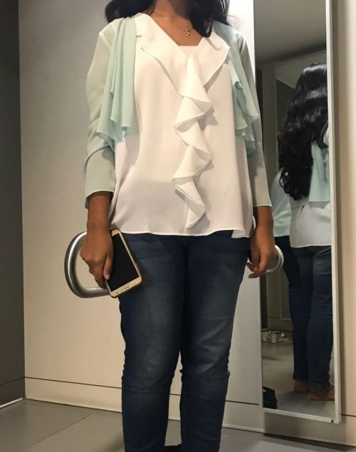 I'm looking for a light mint green silk shrug with a similar white ruffled blouse - SeenIt