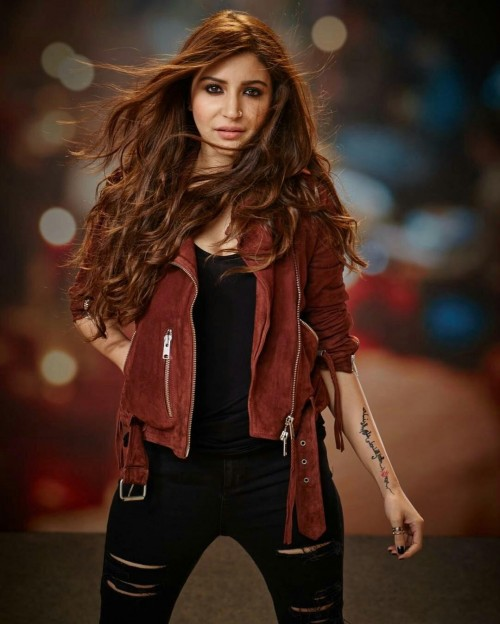 I m looking for a brownish maroon jacket like this of anushka sharma in adhm ...a short brown jacket - SeenIt
