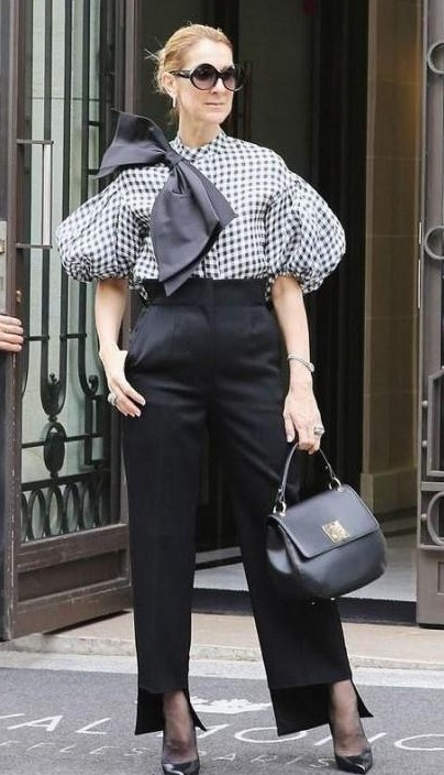 Looking for a gingham top , black flared pants and a black handbag similar to the one which Celine Dion is wearing - SeenIt