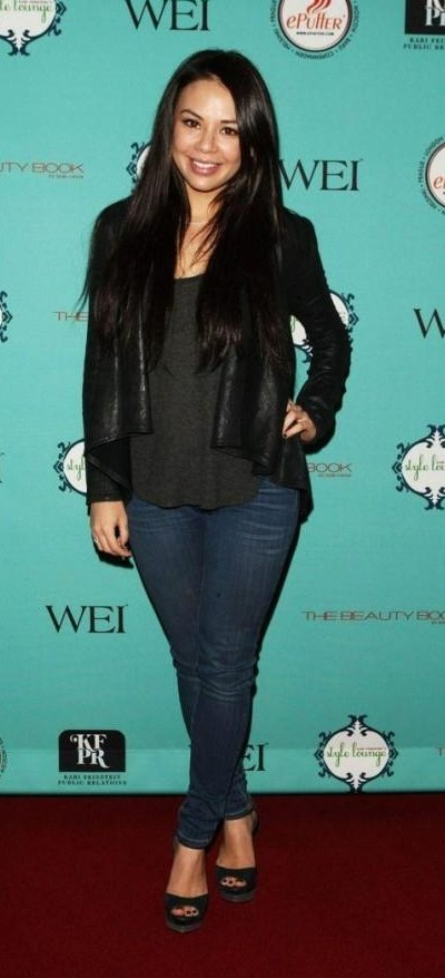 Looking for the black top with black jacket and dark blue jeans that Janel Parish is wearing - SeenIt
